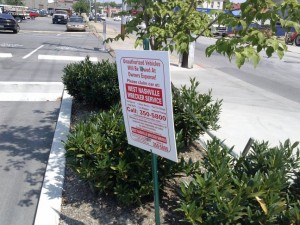 AT&T Wrireless then claimed the lot on which THIS sign was - is AT&T marked. It is not. It is simply a tow sign! NO AT&T Markings!